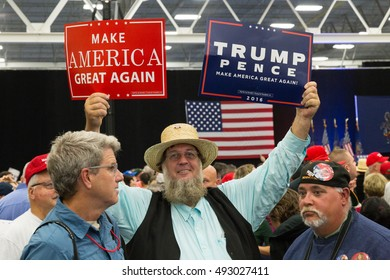 Manheim, PA - October 1, 2016: An Amish man enthusiastically waves a Donald Trump campaign sign at a rally.