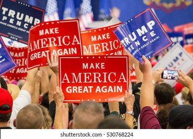 Manheim, PA - October 1, 2016: People enthusiastically wave Make America Great Again Signs at a Donald Trump campaign rally.