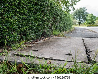 Manhole cover, drainage culvert hole system on the asphalt road side.