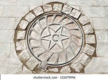 Manhole cover with the image of star