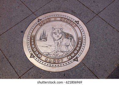 Manhole cover in Wolf Street in Banff in Canada.