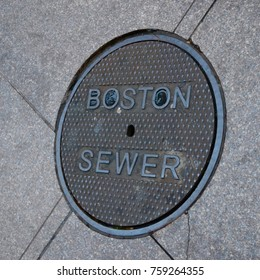 Manhole service cover on the sidewalk