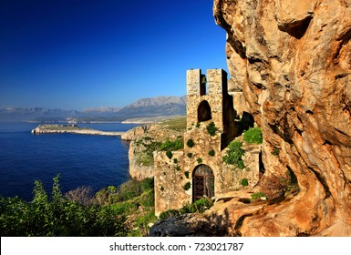 "MANI, PELOPONNESE, GREECE. The ""hidden"" byzantine church of Agitra (also known as ""Panagia Odigitria"") with Cape Tigani in the background. Mani region, Lakonia prefecture, Peloponnese, Greece"