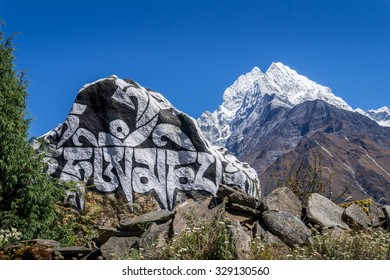 Mani stone against Thamserku mountain near Namche Bazaar, Everest region, Nepal