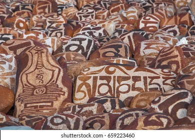 Mani stones with buddhist mantra Om Mani Padme Hum engraved in Tibetan near holy lake Manasarovar in Tibet, China