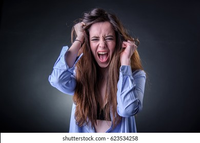 Maniac woman screaming, angry and frustrated, white background, very long hair