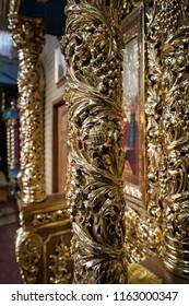 MANIAVA, UKRAINE - 2 NOVEMBER 2017: Golden interiors of Manyava Skete of the Exaltation of the Holy Cross, known as Ukrainian Athos in Carpathians of western Ukraine at the 2nd of November 2017