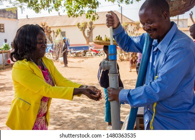 Manica, Mozambique - August 2, 2019: Hand water pump innovation being used for hand washing in Africa