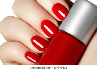 Beautiful Manicured Womans Hands With Red Nail Polish Bottle Of