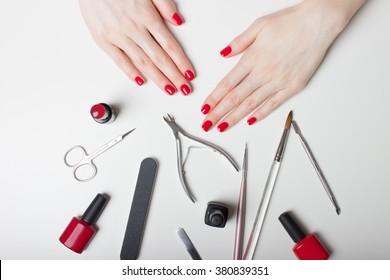 Manicure - Beautiful manicured woman's nails with red nail polish