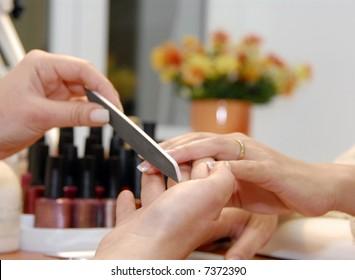 a manicure is in a beauty salon