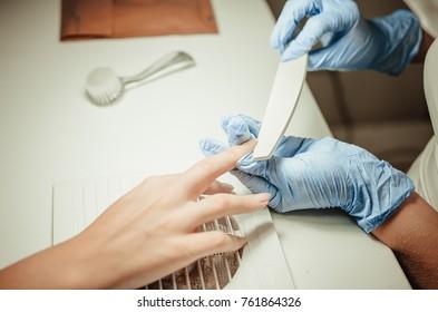 Manicure in a beauty salon. Professional workplace