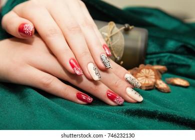 Manicure - Beauty treatment photo of nice manicured woman fingernails. Very nice feminine nail art.