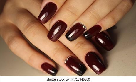 Manicure design nails gradient burgundy with black