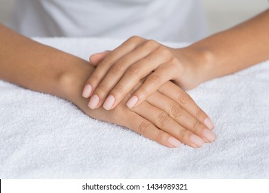 Manicure. Girl With Nude Nails, Getting Professional Procedure In Beauty Salon, Closeup
