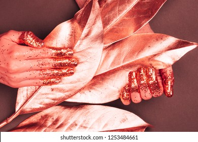 Manicure with glittering fingers. Art fashion inspired by Living Coral - colot of the Year 2019.