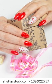 Manicure and Hands Spa. Beautiful Woman Hands with red nail Polish