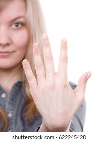 Manicure and hygiene concept. Blonde woman presents hand fingers. Girl with palm without varnish nail polish. French nails style.