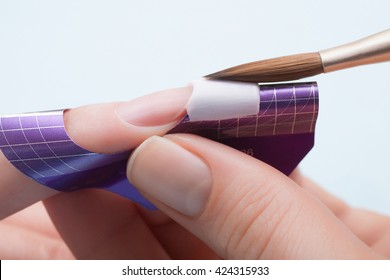 Manicure. Master make nail extension. Finger closeup