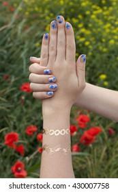 manicure and mehendi on poppy background