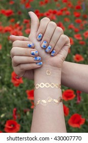 manicure and mehendi on poppy background