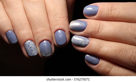 Manicure nail design blue with lace and sequins gradient