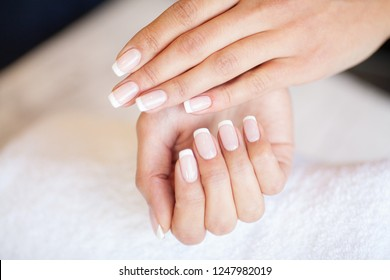 Manicure. Nails master doing manicure in beauty studio.
