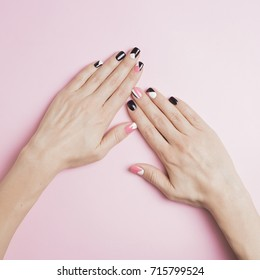 Manicure nails on a pink background
