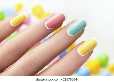 Manicure on an oval shaped nails in pastel colored tones