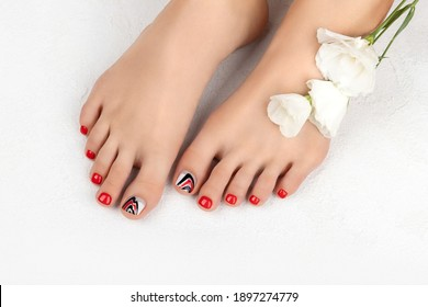 Manicure, pedicure beauty salon concept. Womans feet on gray background