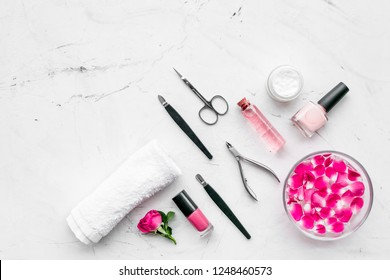 manicure and pedicure equipment for nail bar set on white stone background top view mockup