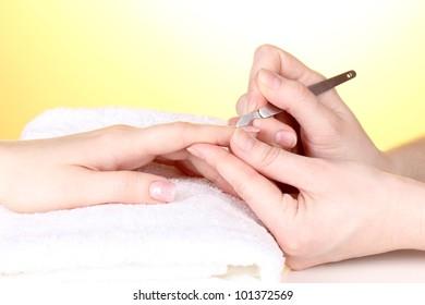 Manicure process in salon