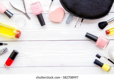 manicure set and nail polish on wooden background