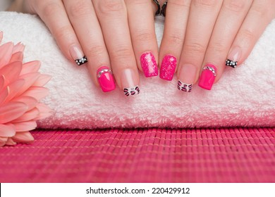 Manicure treatment. Close up of female hands. Very interesting nail art on fingernails.