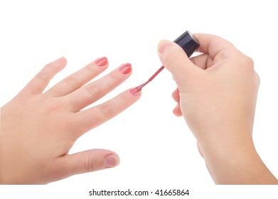 Manicure. Woman applying red nail polish isolated on white