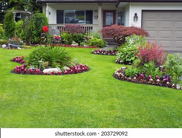 Manicured House and Garden displaying annuals and perennials in full bloom.