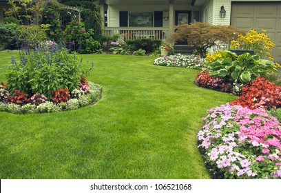 Manicured Yard.  A beautifully manicured residential yard full of blossoms.