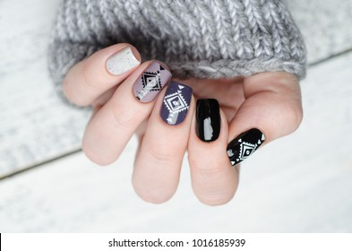 manicures in the Scandinavian style in black white gray and purple color pattern