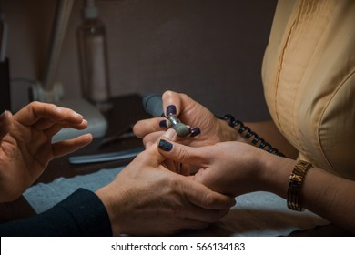 Manicurist and client are chatting during procedure in a beauty salon