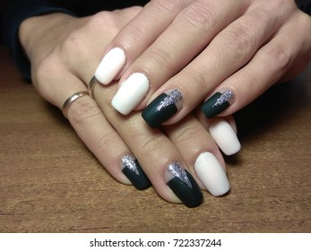 The manicurist excellently made her work a beautiful manicure with a polish gel on her hands and the client is happy