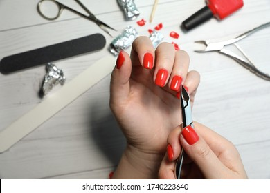 Manicurist makes himself a manicure with professional tools for manicure. Manicure Nails service. Tools of a manicure set