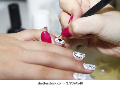 manicurist makes the new gel polish manicure, close-up, beauty and body care
