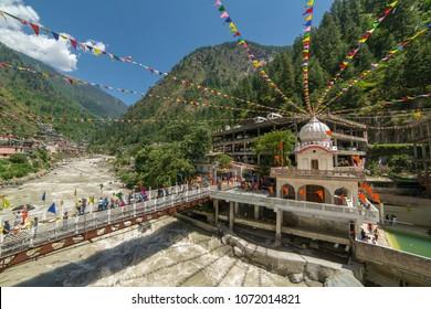 Manikaran, India - June 2, 2017: Sikhs Gurdwara Sahib, bridge over Parvati river and hot springs in Manikaran, Himachal Pradesh, Northern India.