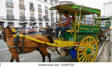 MANILA, PHILIPPINES—AUGUST 2014: A kalesa or horse-drawn carriage at the historic Intramuros area in Manila, Philippines.