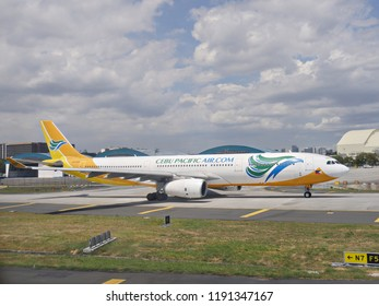 MANILA, PHILIPPINES—MARCH 2018: A Cebu Pacific Air aircraft taxis on the runway getting ready to take off from the Ninoy Aquino International Airport.