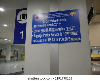 MANILA, PHILIPPINES—MARCH 2018: Sign at the at the Ninoy Aquino International Airport reminding passengers pushcarts are free.