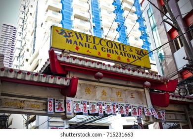 MANILA, April 23, 2016 - The entrance gate to Manila Chinatown in front of a condominium building.