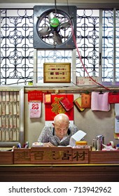MANILA, April 23, 2016 - An old man of Chinese heritage is doing administrative work in a Chinese temple.