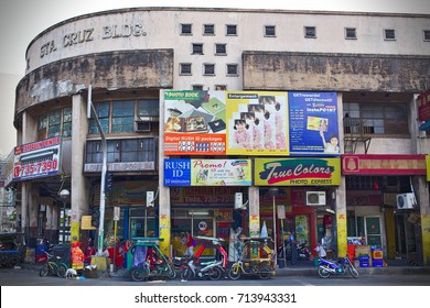 MANILA, April 23, 2016 - A typical building in Central Manila with Tuk Tuks parked in front of it.
