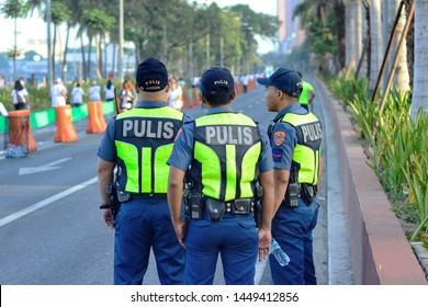 Manila Bay, Philippines April 27,2019 Philippine Police,Maintaining Peace and Safety during a Fun Run Event